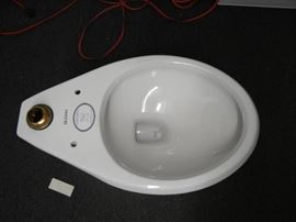 1 New in box  Sloan Toilet Base Only..