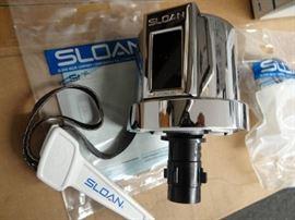 New in box Sloan Optima Plus Flushometer.