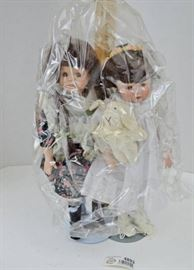 2 Porcelain Dolls w Plastic Protector