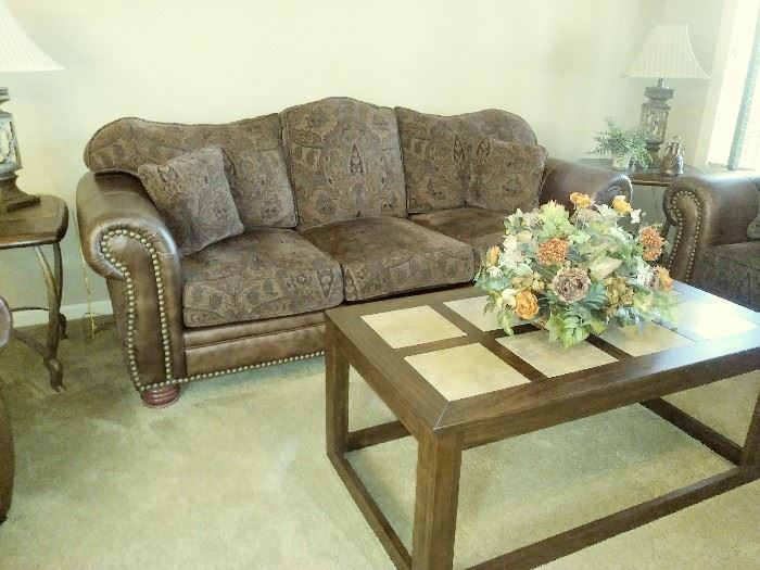 Beautiful leather and upholstered sofa. Like new!