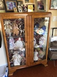 glass cabinet and dolls
