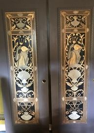 A pair of four hand painted doors ( there are a total of four) that came out of an apartment at the walnuts painted by the late artist Rod Schue