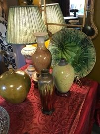 A group of ceramics on the center coffee table
