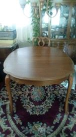 oval dining room table & rug