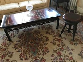 Coffee table, piano stool and rug.
