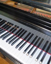 Samick black baby grand piano
