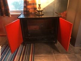 1960s Asian Modern Black & Asian Red Lacquered Cabinet Oriental Relief Bi-Fold Doors Rolled Edge Gold Accent Brass Caps. TV has been removed. It was given as a Christmas gift from  Senator Barry Goldwater