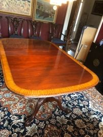 Dining room table with two extra leaves and claw feet