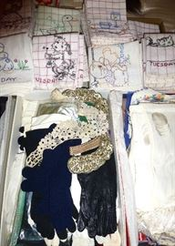 Stacks of vintage kitchen linens and ladies accessories.