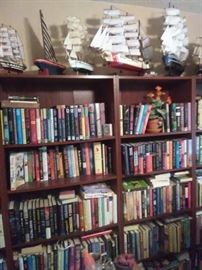 Tons of books many are sailing or Golf related