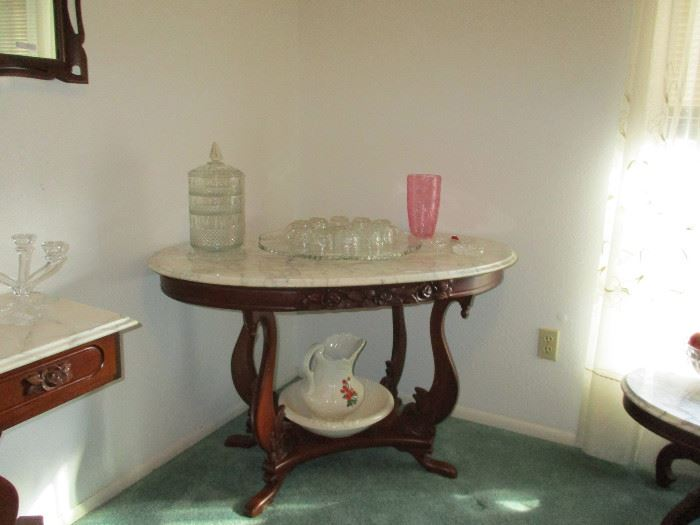Nice Foyer or Library Table notice the SWANS carved that support the nice Marble Top