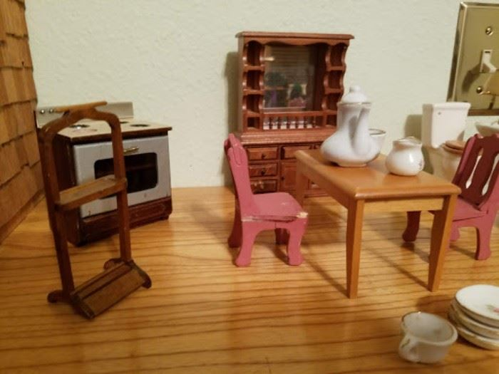 Lots of vintage dollhouse furniture.