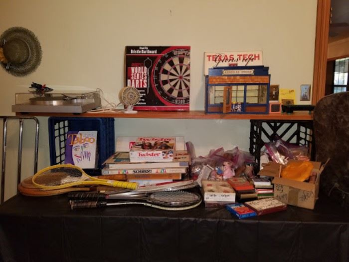 Vintage games, tennis rackets, and cards.