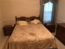 $500.  5 piece Queen bedroom suite.  Headboard, two bedside tables, dresser with mirror, and chest of drawers.  there is a shadow on the bed from the light fixture, it's not a stain.
