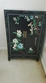 Asian inspired accent cabinet