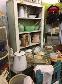 tons of vintage enamel ware and rustic shelves/cabinets