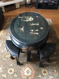 Asian mother of pearl coffee table, under glass