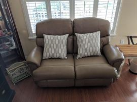Matching leather loveseat is also in like-new condition and has dual recliners