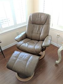 Light tan leather stress-less chair with ottoman