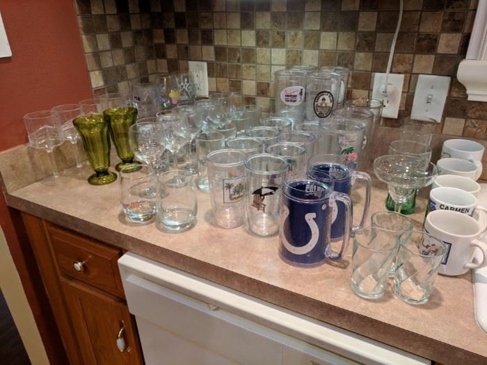 Large selection of Tervis cups and various glassware