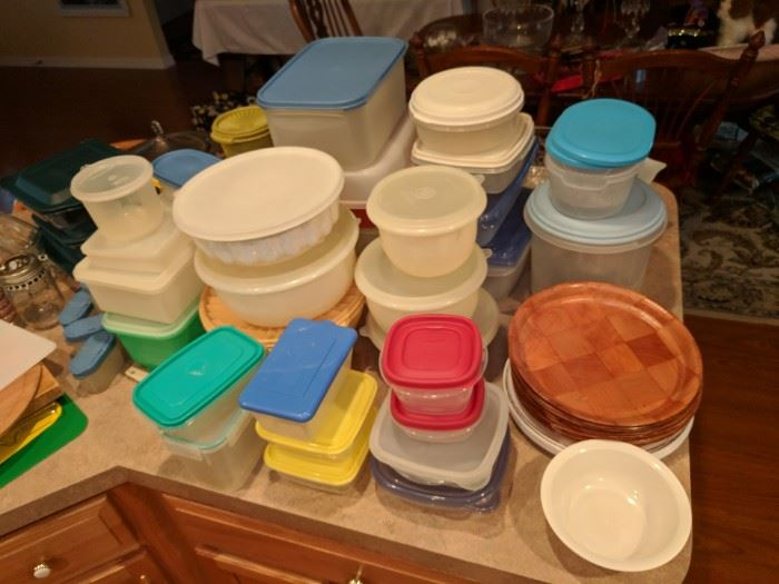 Plastic containers of various sizes including many Tupperware pieces