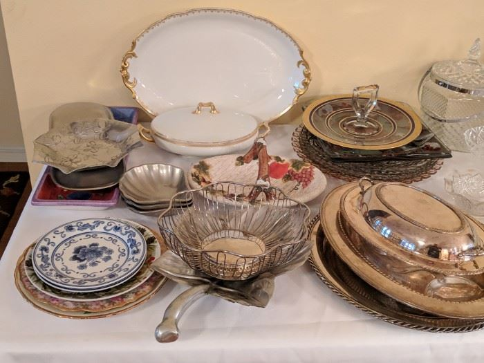 Numerous serving platters and dishes in addition to several antique pieces