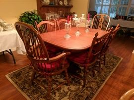 Dining table seats 6 as pictured. Also includes custom fit table pads and 2 leafs