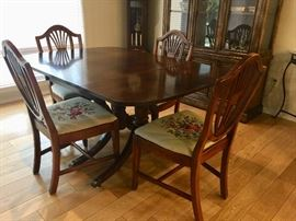 "Duncan Phyfe style drop leaf table w/4 chairs, extra leafs and pads 42"" x 59"" as shown"