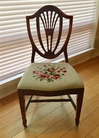 One of four dining chairs with table