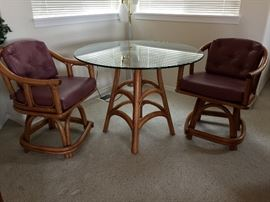 Ratan glass top table and two chairs