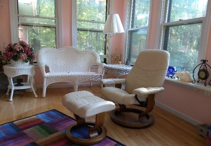 some of the wicker furniture & the cool leather mid-century chair with ottoman