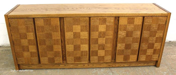 "Mid Century Modern Oak and Walnut Parquetry Front Fitted Credenza by ""Conant Ball Furniture Makers""  Located Inside – Auction Estimate $300-$600"