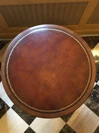 Leather top round table with excellent gold leaf embossed/tooled surround