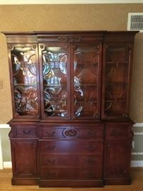 """Dining Room cabinet with fold-down """"secretary"""" front and curved glass."""