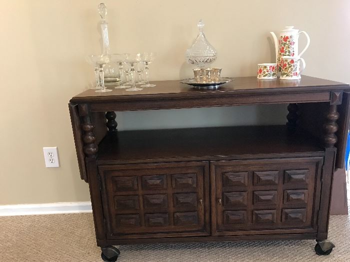 This bar cart is ready for some egg nog or something stronger! This is a fabuuuulous piece!