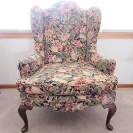 Floral wing back chair with queen anne style legs.