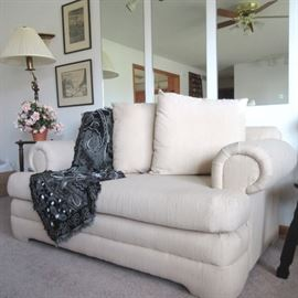 Clean ivory sofa with extra pillows (all not shown here).