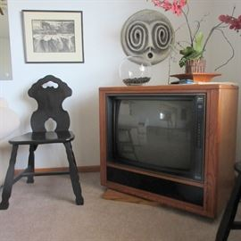 This is one of two black shaker style side chairs and Zenith console TV.