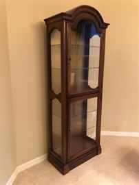 Curio cabinet with lights, top and bottom