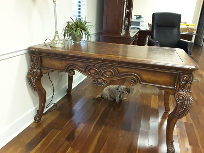 carved executive desk table is structurally in good condition just needs a little TLC. I think it would look fabulous with a new paint finish!