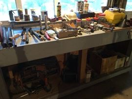 lots of small tools    and this huge not light work bench -which at least is by the garage door for somewhat easier moving