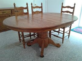Close up of pedestal dining room table with Leaf in