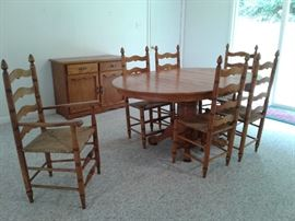 Golden oak dining room set also has a hutch that sits on top of dining room dresser