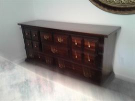 Dresser matches chest of drawers nightstand and king size bed with under-bed storage.