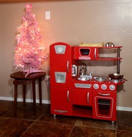 Many Children's Items. Great Christmas Gifts! Pink lighted Christmas Tree. sitting on Antique drop leaf table with drawer.