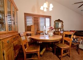 Antique Oak Round Dining Table with leaf and chairs. Chairs have leather seat insets. China Cabinet to match.