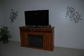 """RCA 50"""" FLAT SCREEN TELEVISION, MEDIA STAND WITH FIREPLACE, METAL WALL DECOR"""