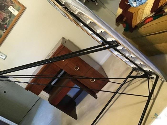 """Ironing Board / Item(s) Description 54""""x17""""  How Many in Lot 1  Wear/Tear Has one bar bent but still opens and closes ok  Number of Photo 4  Location Downstairs Bedroom"""
