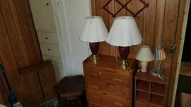 Dressers and small side tables with lamps