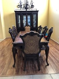8 Chairs and one Dining Table $800. Cabinet behind the table $500